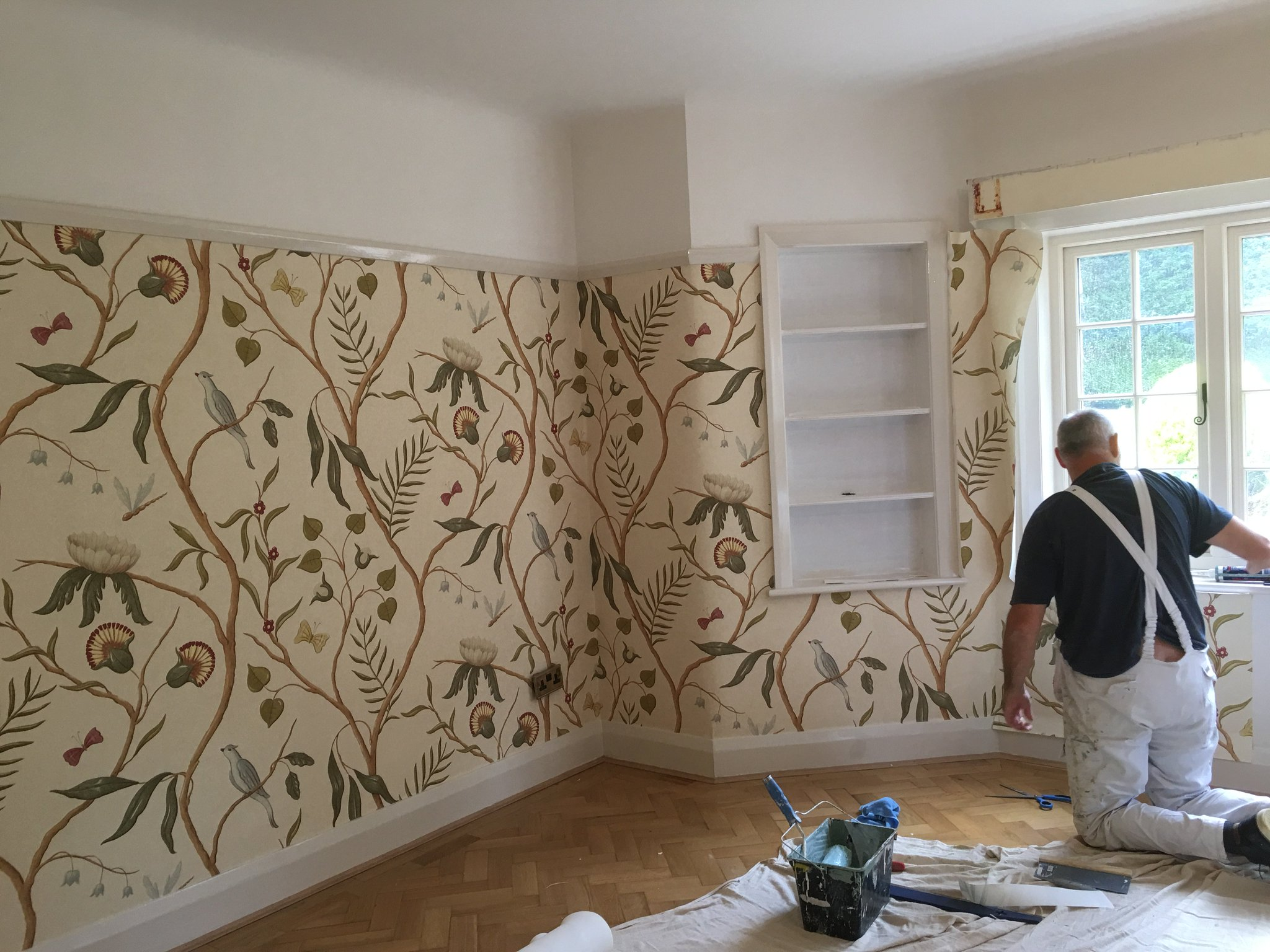 Steve Hughes wall papering house